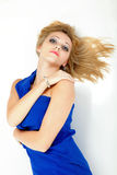 Woman lying lovely girl in blue dress over white Royalty Free Stock Photography