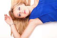 Woman lying lovely girl in blue dress over white Royalty Free Stock Photo