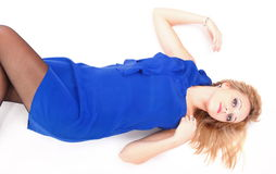 Woman lying lovely girl in blue dress over white Royalty Free Stock Images