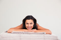 Woman lying on massage lounger Stock Images