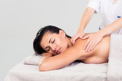 Woman lying on massage lounger Royalty Free Stock Photography