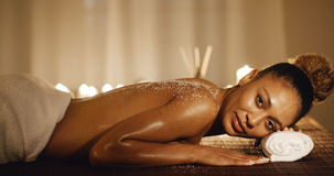 Woman Lying On Massage Table With Salt Scrub Royalty Free Stock Image