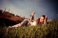 Woman lying in meadow Stock Image