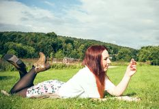 Woman lying in a meadow Stock Photos