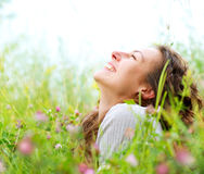 Woman lying in Meadow of Flowers Stock Images