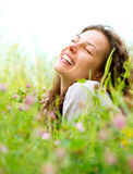 Woman lying in Meadow of Flowers stock photography