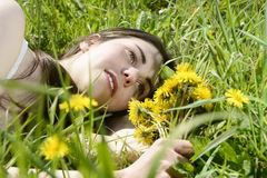 Woman lying on meadow Stock Photography