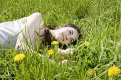 Woman lying on meadow Stock Photo