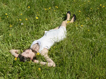 Woman lying on meadow Royalty Free Stock Image