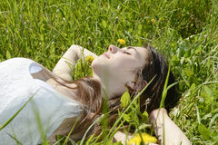Woman lying on meadow Royalty Free Stock Images