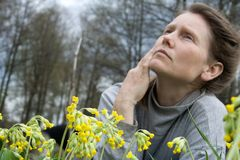 Woman lying at nature Stock Images