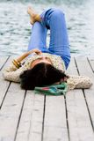 Woman lying near the river Stock Photography