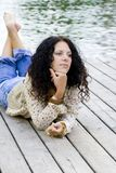 Woman Lying Near The River Stock Photos