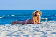 Woman Lying On The Beach Stock Photo
