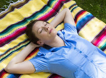 Woman lying in Park Stock Photo