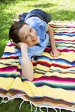 Woman lying in Park Royalty Free Stock Image