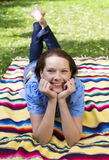 Woman lying in Park Royalty Free Stock Photography