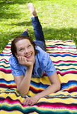 Woman lying in Park Royalty Free Stock Photos
