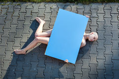 Woman lying on the pavement. Royalty Free Stock Photo
