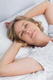 Woman lying peacefully in bed Royalty Free Stock Image