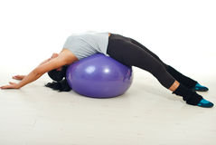 Woman lying on pilates ball royalty free stock images