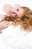Woman lying on pillow Royalty Free Stock Photography