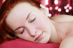 Woman lying on a pillow. Stock Photos