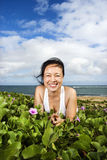 Woman Lying in Plants Near Beach Stock Images