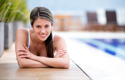Woman lying by the pool Royalty Free Stock Photography