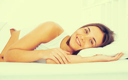 Woman lying poses Royalty Free Stock Photography