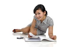 Woman Lying While Reading Book Royalty Free Stock Photography