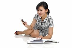 Woman Lying While Reading Book Royalty Free Stock Photos