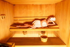 Woman lying relaxed in wooden sauna Royalty Free Stock Photos