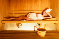 Woman lying relaxed in wooden sauna Royalty Free Stock Photography