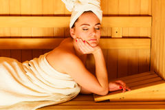 Woman lying relaxed in wooden sauna Royalty Free Stock Images