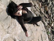 Woman lying on a rock Stock Photography