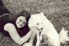 Woman lying Samoyed Royalty Free Stock Photography