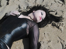 Woman lying on the sand Royalty Free Stock Photography