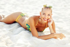 Woman lying on the sand Royalty Free Stock Images