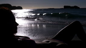 Woman lying on the sand. On the beach stock video footage