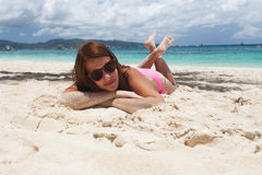 Woman lying on the sand at the beach Royalty Free Stock Photo
