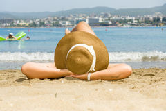 Woman lying on the sand. Stock Photos