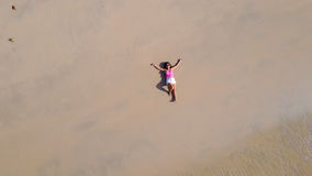 Woman lying on sand Royalty Free Stock Photos