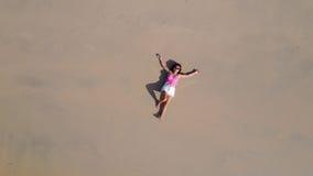 Woman lying on sand Stock Photo