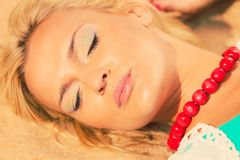 Woman lying on sandy beach relaxing during summer Royalty Free Stock Photo