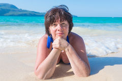 Woman lying in the sea Stock Photography