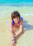 Woman lying in the sea Royalty Free Stock Photography
