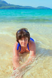 Woman lying in the sea Royalty Free Stock Images
