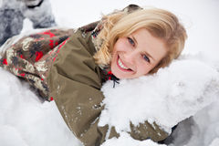 A woman is lying at the snow in the park Stock Images