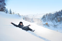 Woman lying in the snow in the winter Stock Images